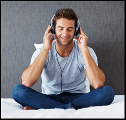 Relaxed young guy listening to peaceful music